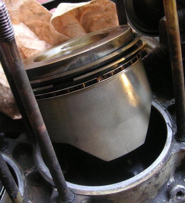 маслос'емниє поршневі кільця